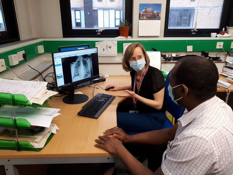 Dr Ahmed and Dr Louise Berry reviewing a chest X-ray.