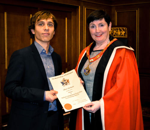 Oliver Shutkever, receiving his award from newly-appointed President, Professor Jo Martin